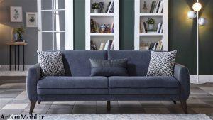 یک مبل راحتی دارای قاب طراحی شده به گونه ای است که از حالت نشسته آسان و بلند می شود.